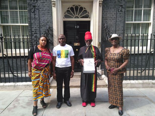 Green Councillor Cleo Lake stands outside 10 Downing Street with three reparations campaigners