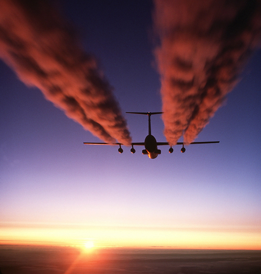 An image of a plane flying at high altitude